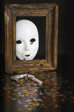 White mask in an old frame Royalty Free Stock Image