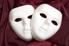 White mask and red silk Royalty Free Stock Photo
