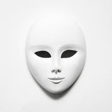 White mask on white paper royalty free stock image