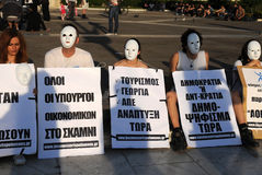White-Masked Protesting in Athens Royalty Free Stock Images