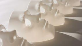 White masks on white background, depression metaphor stock footage