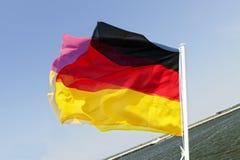 White mast with waving german flag Stock Photos