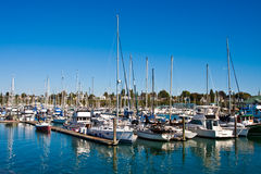 White Masts Reflected in Blue Water Royalty Free Stock Image