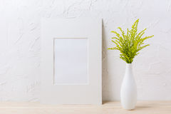 White mat frame mockup with ornamental grass in exquisite vase Stock Images
