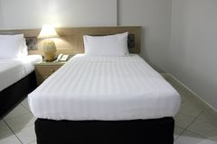 White mattress and black bed stock images