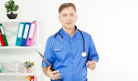 White mature male doctor in medical office copy space, health care medical insurance stock image
