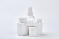 White medical containers set isolated. Plastic remedy boxes. Precaution of illnesses Stock Photography