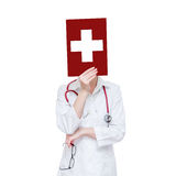 White medical cross. Woman doctor closes face sheet with a cross Stock Photo