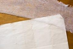 White medical gauze bandage. White gauze bandage on a wooden background Stock Image