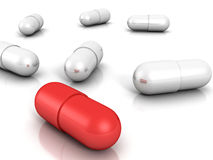 White medical pill capsules with red one on white background Stock Image