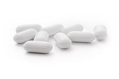 White medical tablets over white Stock Photos
