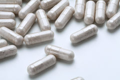 White medicine capsules probiotic powder inside. Close up. High resolution product.  Health care concept Stock Image