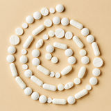 White medicine pills on beige background Royalty Free Stock Image