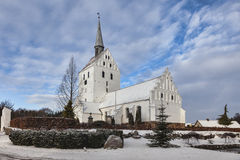 White medieval church in Svindinge, Denmark Stock Image