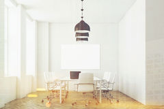 White meeting room with lamps, toned Stock Photo