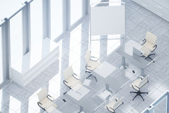 White meeting room top. Top view of white meeting room with empty whiteboard stand, workplace and sunlight Mock up, 3D Rendering. Filtered image Stock Image