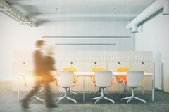 White meeting room, yellow chairs, people. White meeting room interior with a long table and rows of yellow and white office chairs standing near it. People. 3d Stock Image