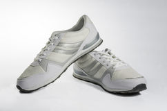 White men's sneakers. White men's shoes on a white background Royalty Free Stock Images