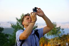 White men taking photo of birds in the sky Royalty Free Stock Images