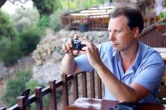White men taking photo of landscape Stock Photography