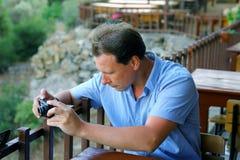 White men taking photo of landscape Royalty Free Stock Images