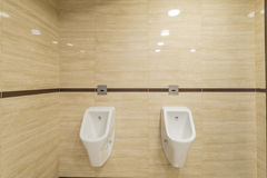 White mens urinals in the background toilet Royalty Free Stock Photo