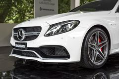 TURIN, ITALY - JUNE 9, 2016 A white Mercedes AMG C63 S Coupè on display at Turin open air car show. A white Mercedes AMG C63 S Coupè on display at royalty free stock photo