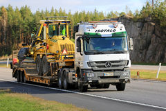 White Mercedes-Benz Actros Hauls Road Maintenance Equipment Stock Images