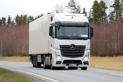 White Mercedes-Benz Actros Semi Truck on Spring Road Stock Photos