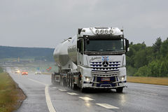 White Mercedes-Benz Actros Tank Truck Trucking in Rain Royalty Free Stock Photo