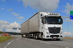 White Mercedes-Benz Actros Truck Trailer in Traffic Royalty Free Stock Image