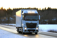 White Mercedes-Benz Actros Trucking at Sunset Royalty Free Stock Photography