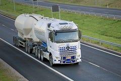 White Mercedes-Benz Arocs For Cement Haul on Motorway Stock Image