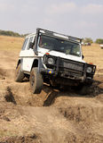 White Mercedes-Benz G-Class on 4x4 Course Stock Photography