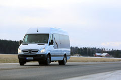 White Mercedes-Benz Sprinter Minibus on the Road. JOKIOINEN, FINLAND - DECEMBER 3, 2016: White Mercedes-Benz Sprinter minibus at speed on the road in winter Royalty Free Stock Images