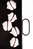 White meringue cookies with chocolate on black baking tray. Meringue cookies with chocolate on black baking tray Royalty Free Stock Image