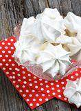 White Meringue Cookies. In Dessert Vase on Red Polka Dot Napkin cross section on Wooden background Royalty Free Stock Image