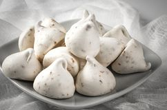 White meringues on a gray plate Stock Images