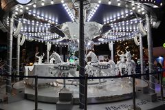 White Merry Go Round at Night stock images