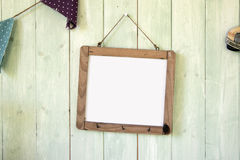 White message board hanging on retro green wooden wall Royalty Free Stock Photography