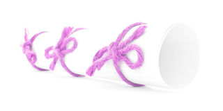 White message scroll tied with cord, three pink knots isolated. White message scroll tied with cord, three pink knots, isolated royalty free stock photo