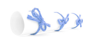 White message scroll tied with string, three blue knots isolated. White message scroll tied with string, three blue knots, isolated royalty free stock photography