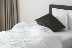 White messy bedsheet and pillow. In the bedroom Royalty Free Stock Photography
