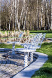 White metal chairs in the park Stock Images