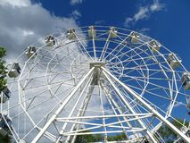 City ferris wheel on blue sky background. royalty free stock images