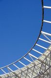 White metal construction with blue sky in the background. White metal construction formed arc and net  with blue sky in the background Stock Images