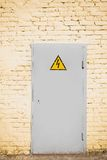 White metal door on yellow wall Royalty Free Stock Photography
