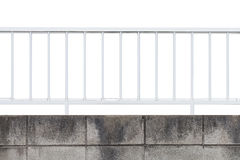 White metal fence and concrete block wall Royalty Free Stock Images