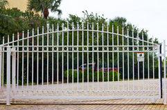 Metal gate. White metal gate and a driveway Royalty Free Stock Photography
