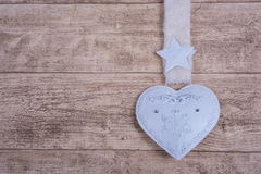 White metal heart on wooden background Royalty Free Stock Photo